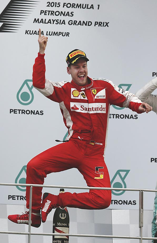 Sebastian Vettel celebrates on the podium after winning the Malaysia Formula One Grand Prix.