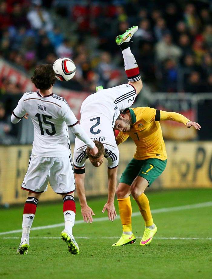 Shkodran Mustafi of Germany is upended as he fights for the ball against Matthew Leckie of Australia during an International Friendly match.
