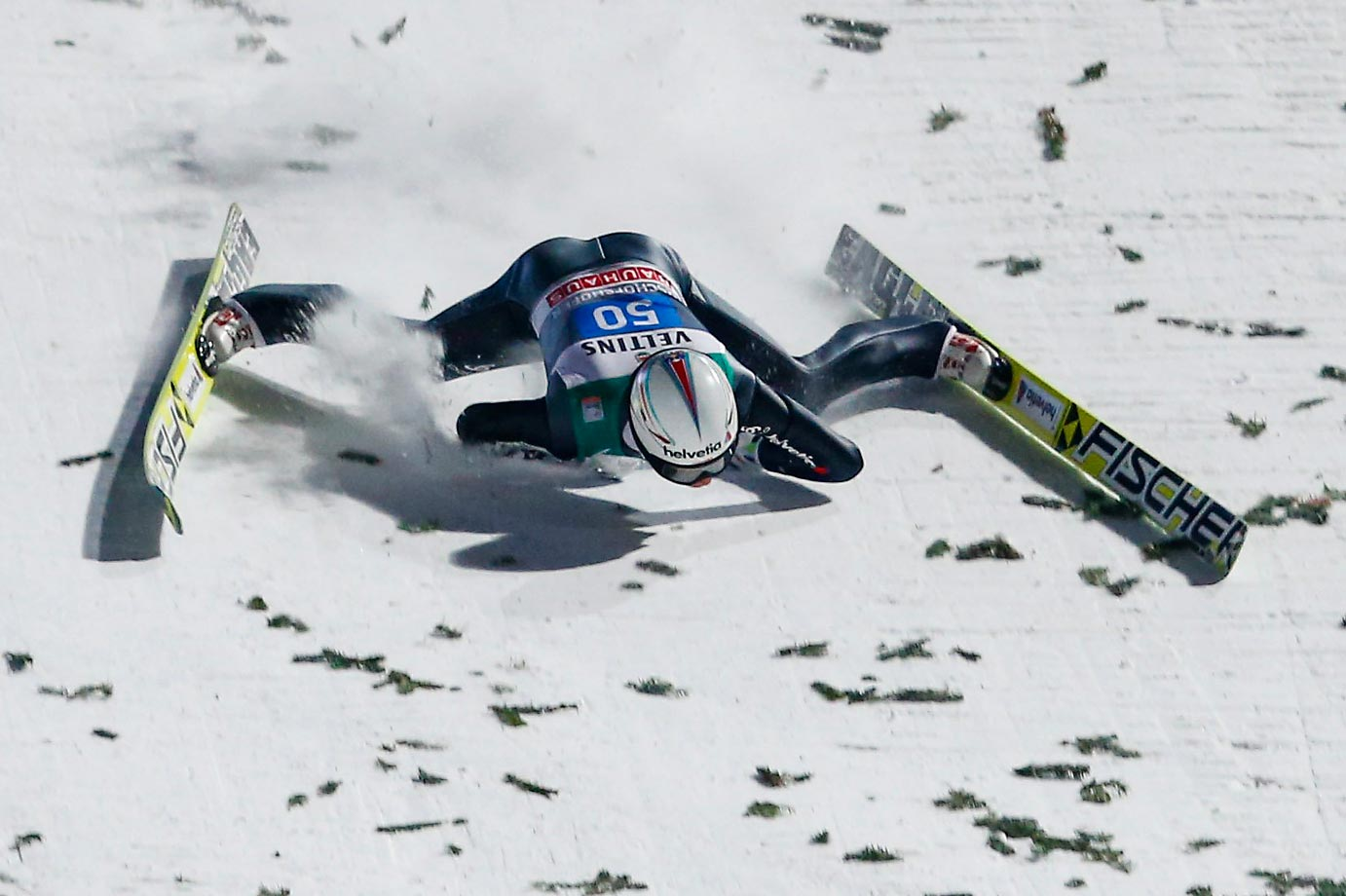 Simon Ammann takes a spill during the FIS Ski Jumping World Cup in Austria.