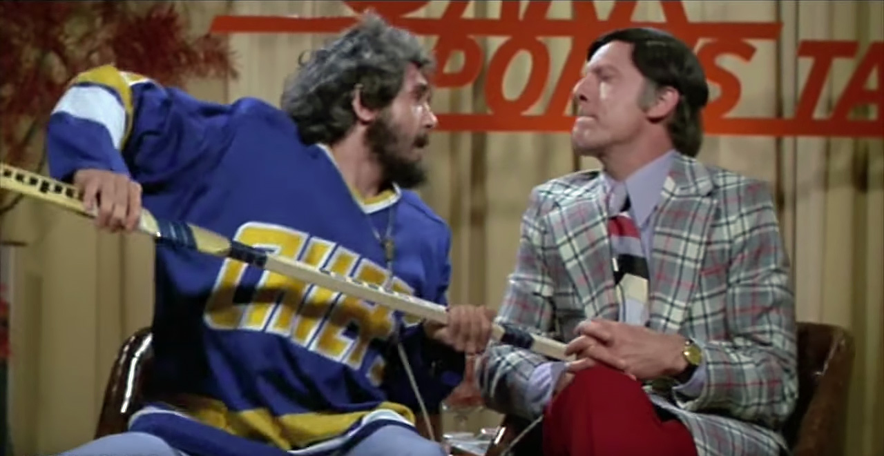 "Jim (asking about slashing): ""And there's a penalty for that?"" Denis: ""Yeah. And for trip also, you know. And for hook like dis. And for spear, you know, like dat. All bad. You do dat, you go to da box, you know. Two minutes by yourself, and you feel shame, you know. And den you get free."""