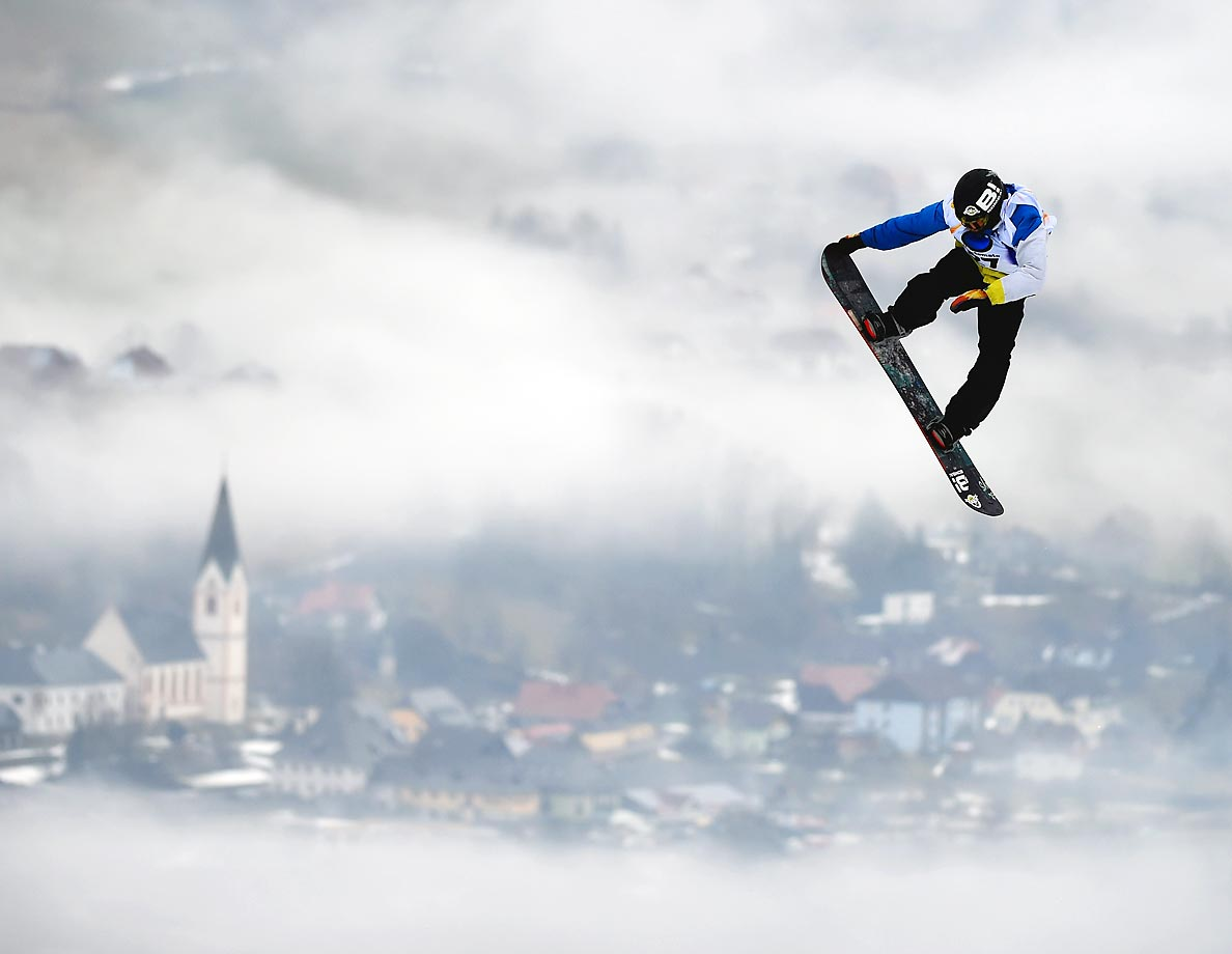 An athlete competes during Snowboard Slopestyle training for the FIS Freestyle Ski World Championships in Kreischberg, Austria.