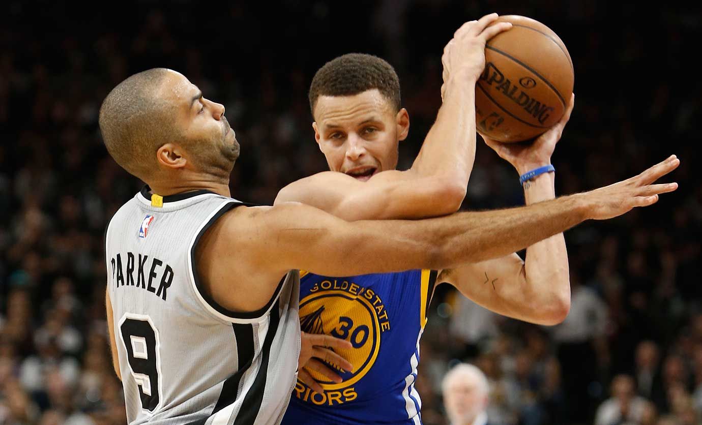 Tony Parker defends Stephen Curry on a night when the Golden State star was held to 14 points.