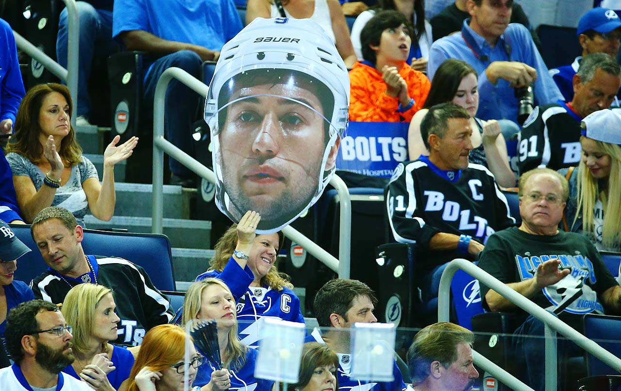 A Tampa Bay fans holds a Tyler Johnson cardboard cut out.