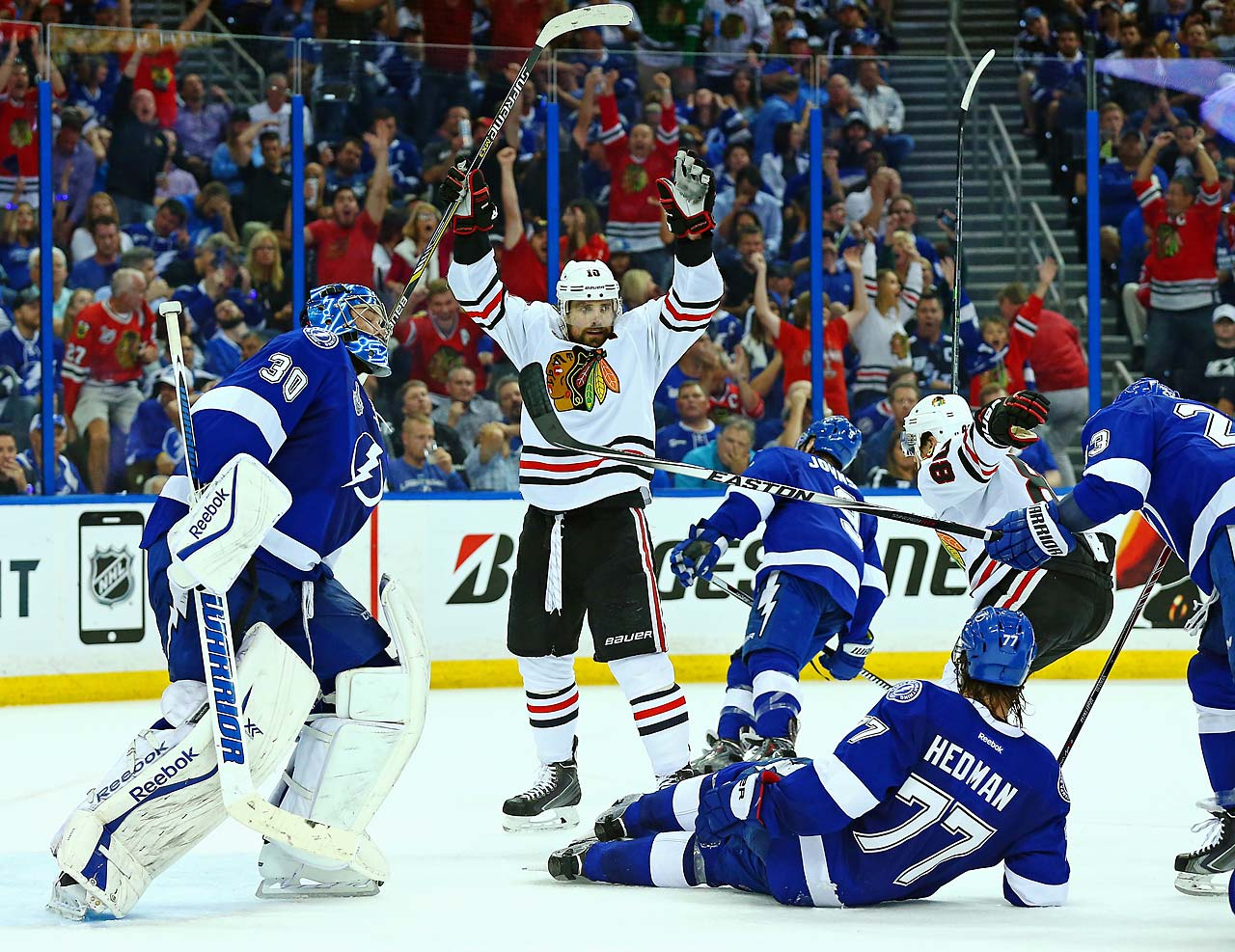 SI's best photos from Game 1 of the Stanley Cup Finals, beginning with Patrick Sharp of the Chicago Blackhawks celebrating a goal. The visitors scored twice in the final seven minutes to take a 2-1 victory over Tampa Bay.
