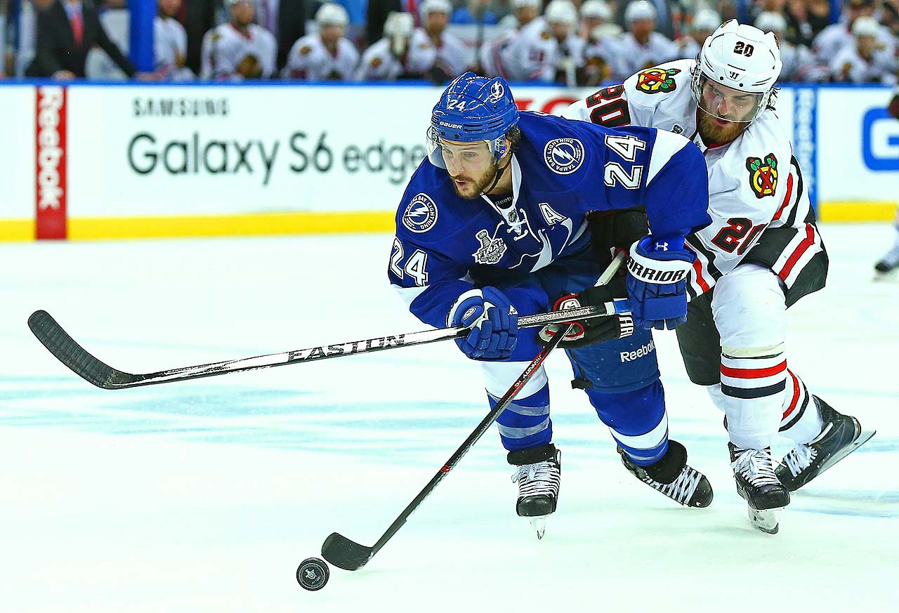 Brandon Saad of the Blackhawks attempts to disrupt Ryan Callahan.