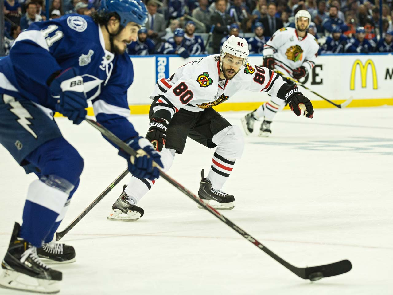 Antoine Vermette (80) of the Blackhawks extends his stick to steal the puck.