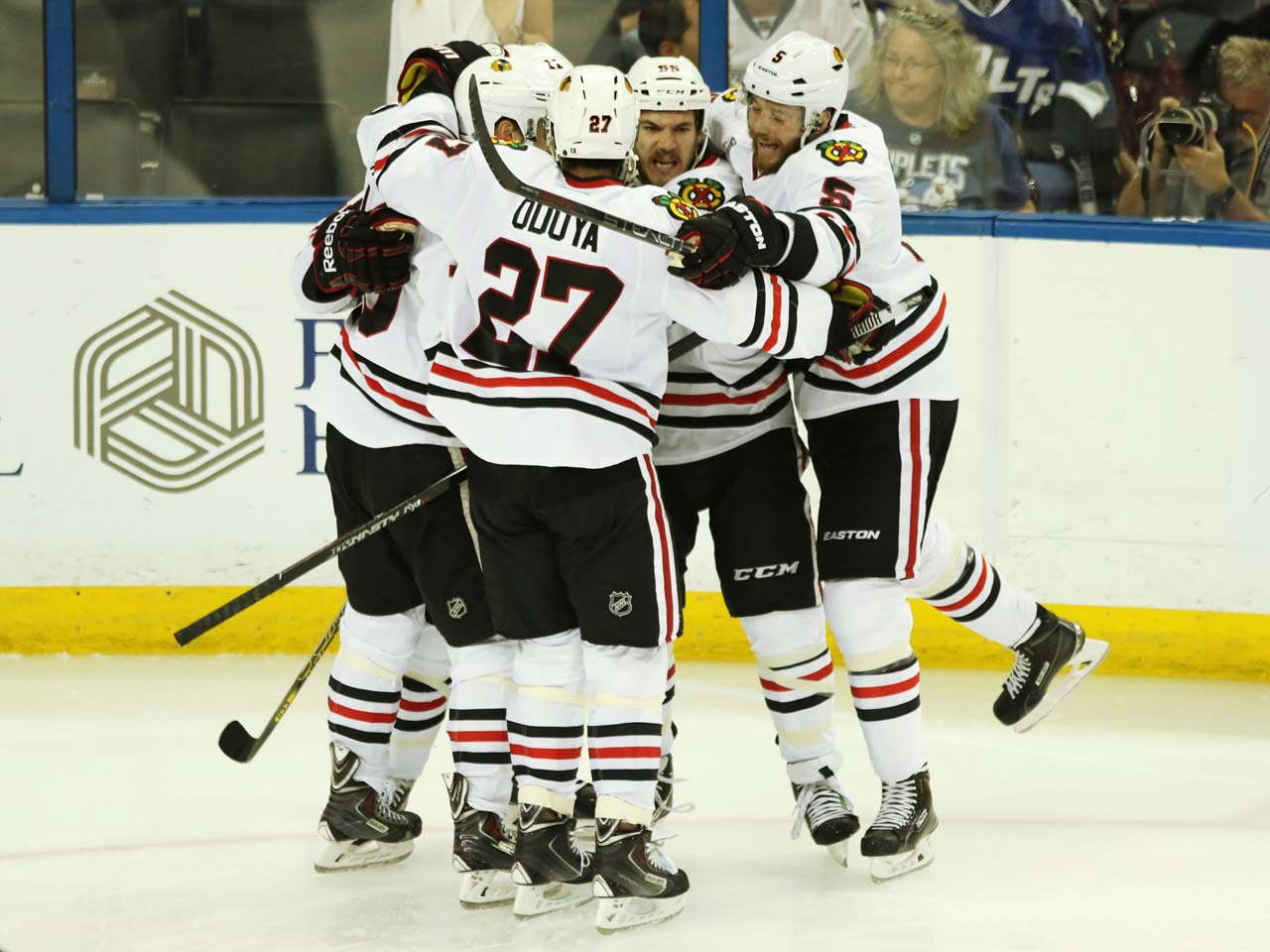 The Blackhawks celebrate after Andrew Shaw scored a goal in the second period.
