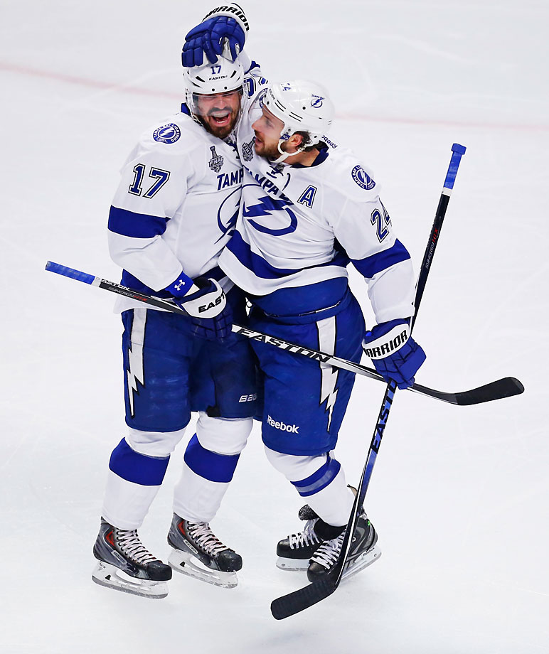 Ryan Callahan (right) celebrates the first goal of game 3 with teammate Alex Killorn.