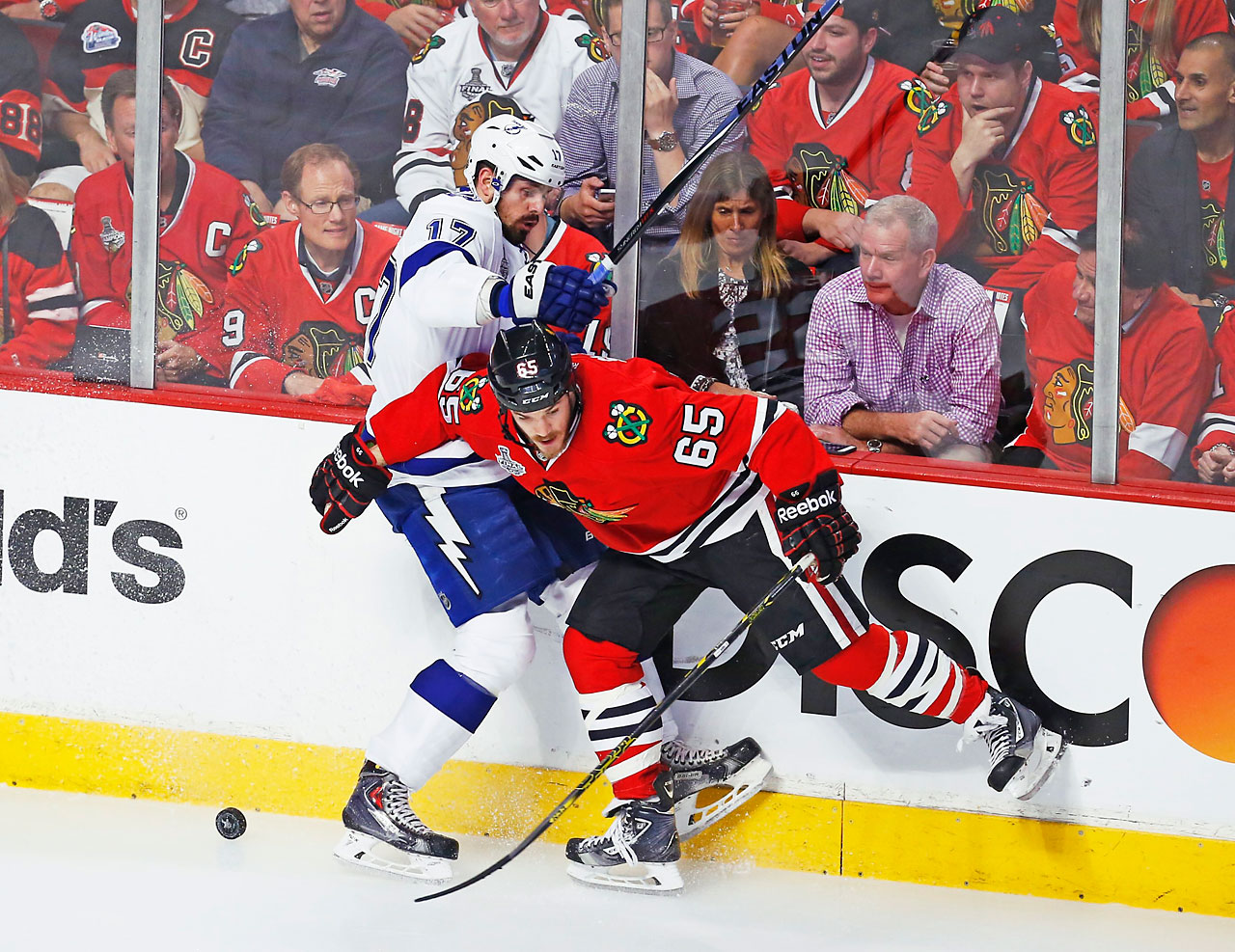 Andrew Shaw fights for the puck against Alex Killorn.