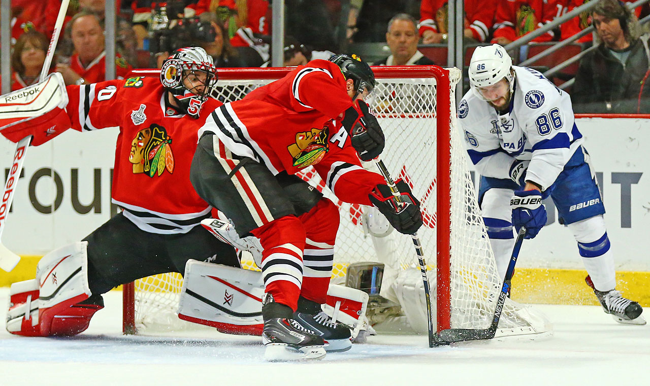Tampa Bay Lightning right wing Nikita Kucherov tries to get one past Corey Crawford.