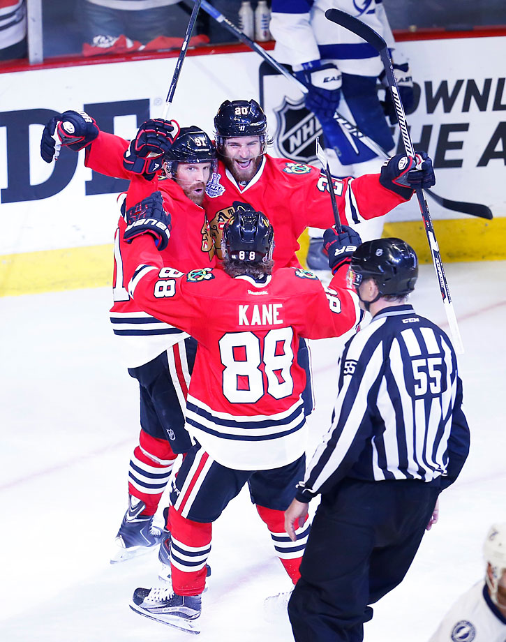 Brandon Saad (20) of the Blackhawks celebrates with teammates after scoring what turned out to be the winning goal.