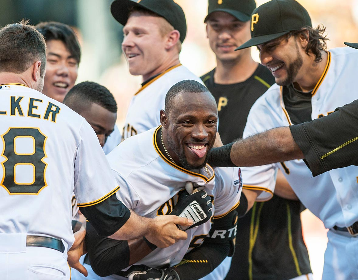 Pittsburgh left fielder Starling Marte is mobbed by his teammates after hitting a walk-off home run in the ninth inning to give the Pirates a 3-2 win over the San Francisco Giants on Aug. 22.