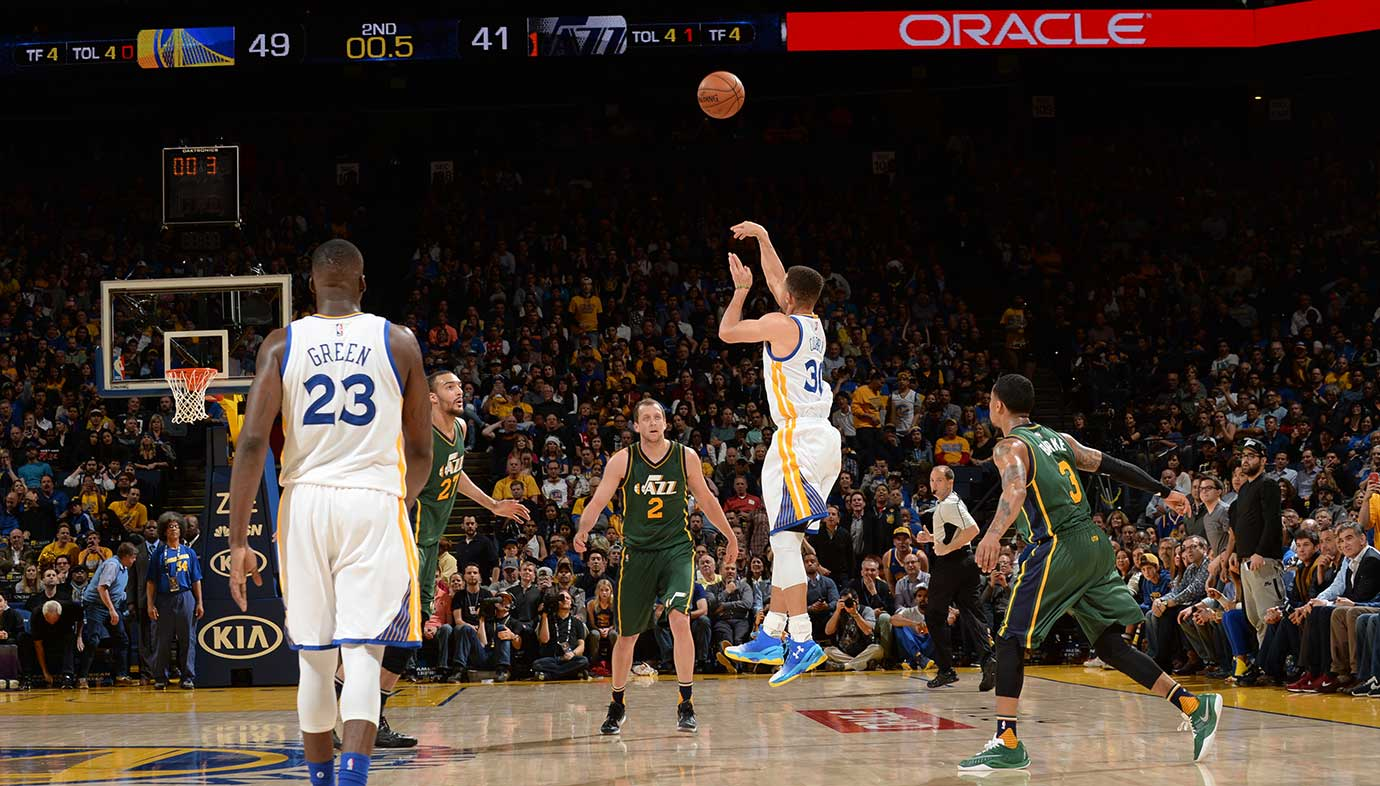 Steph Curry sank this shot from beyond halfcourt just before intermission against Utah Wednesday night.