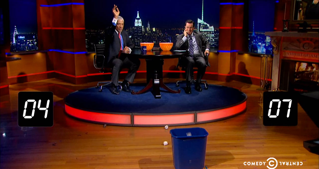 Julius Erving takes on Stephen Colbert in a game of waste basketball on The Colbert Report on Nov. 5, 2013 in New York City.