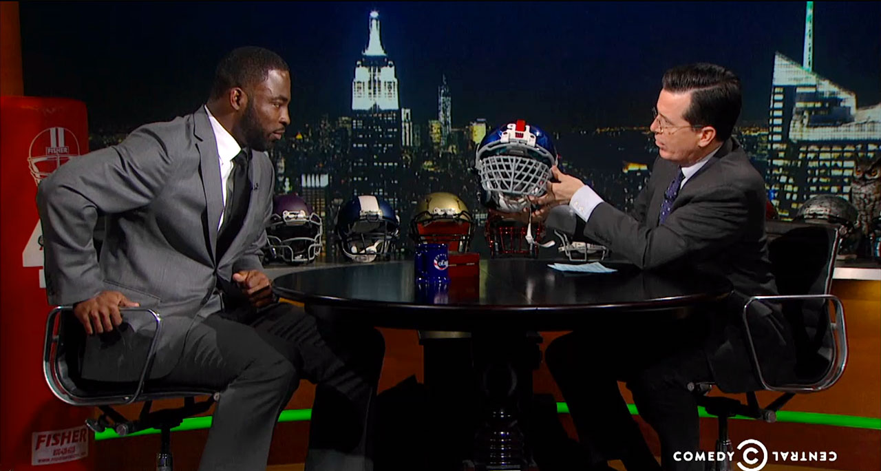 Justin Tuck talks with Stephen Colbert on The Colbert Report on Jan. 28, 2014 in New York City.