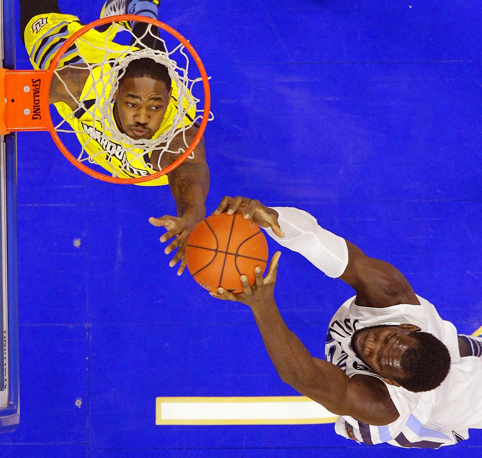 Marquette's Steve Taylor Jr., left, leaps for a rebound against Villanova's Daniel Ochefu in Philadelphia. Villanova won 70-52.