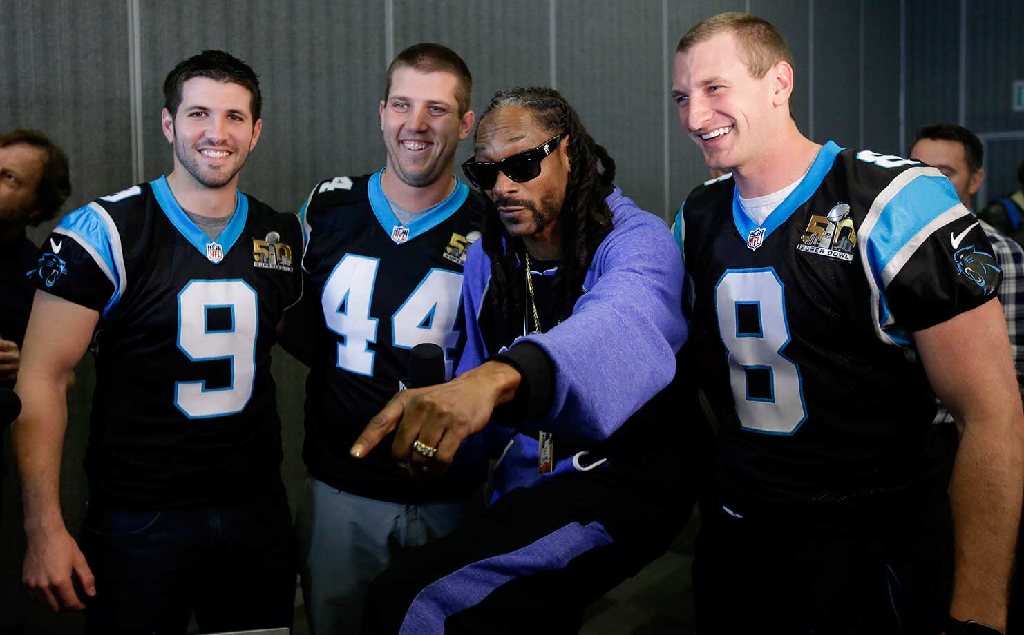 Recording artist Snoop Dogg poses with Carolina Panthers' Graham Gano (9), J.J. Jansen (44) and Brad Nortman in San Jose.