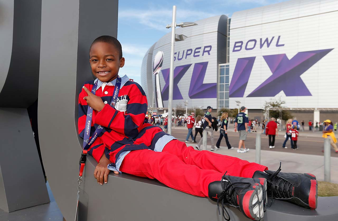 Dayvion Dorsey of Maryland poses outside University of Phoenix Stadium, where Super Bowl XLIX will be held.