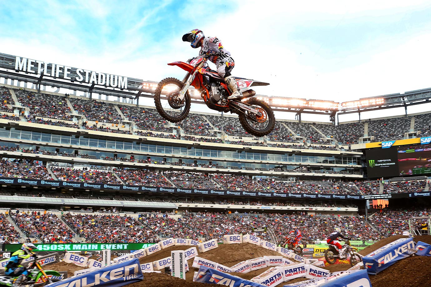 Sports Illustrated contributing photographer Gary Bogdon spent the April 24-26 weekend behind the scenes with Red Bull KTM Racing Team Supercross rider Ryan Dungey (pictured here getting some big air) at the 2015 Monster Energy Supercross race at Metlife Stadium. Dungey, 25, who's already clinched his second 450 Supercross Championship, will finish out the season at the last race on Saturday in Las Vegas.