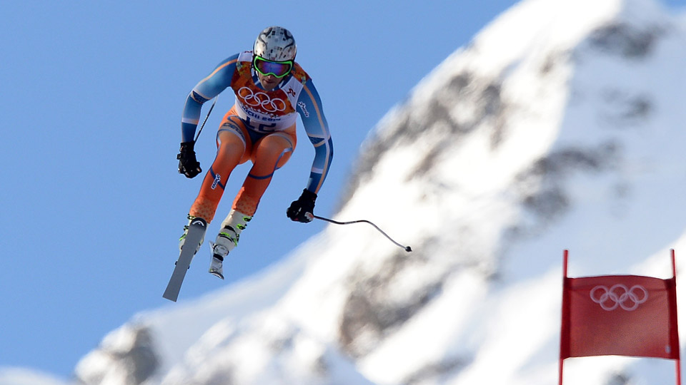 Aksel Lund Svindal gets airborne on the Men's Super Combined downhill course at the Sochi Olympics.