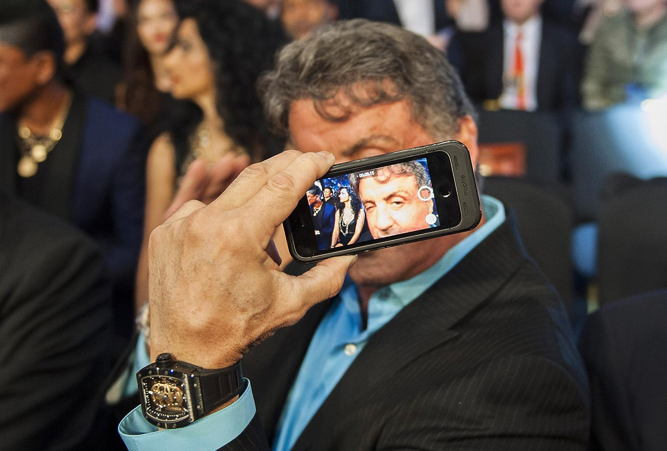 Sylvester Stallone shows a selfie picture he took ringside before the match between Jessie Vargas and Antonio DeMarco.