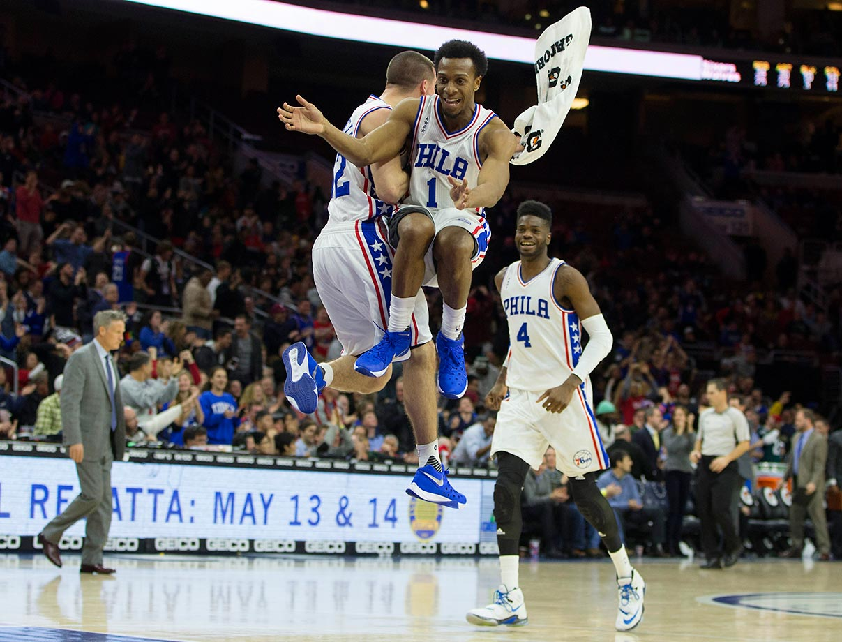 T.J. McConnell, Ish Smith and Nerlens Noel of the 76ers celebrate during a game against the Minnesota Timberwolves.