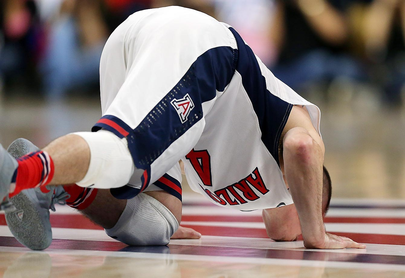 Arizona guard T.J. McConnell kisses the Arizona logo during the second half of a Pac-12 game against Stanford.