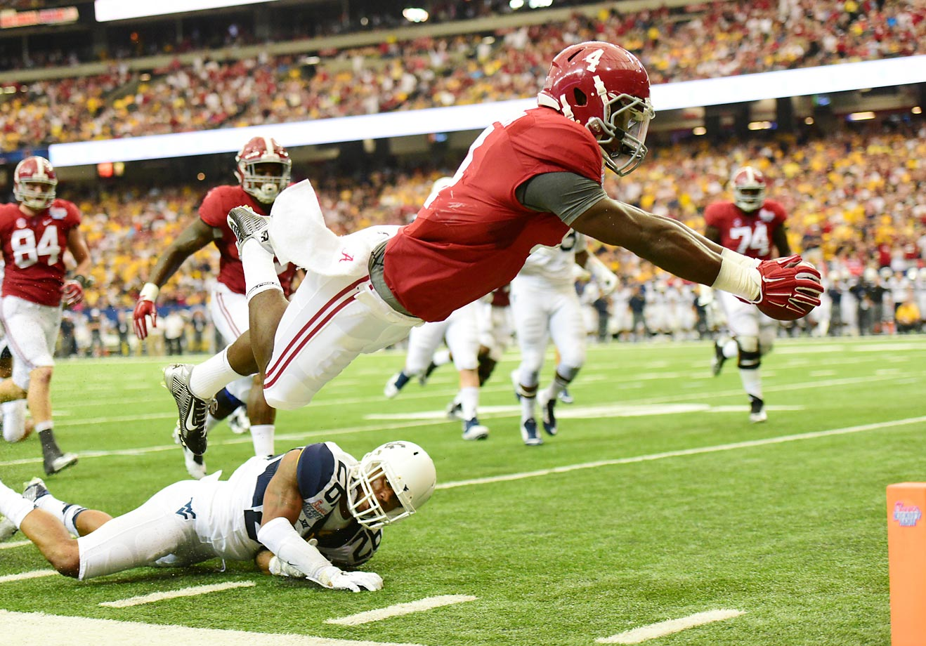 T.J. Yeldon of the Alabama Crimson Tide dives for a touchdown against Travis Bell of the West Virginia Mountaineers at the Georgia Dome on Aug. 30.