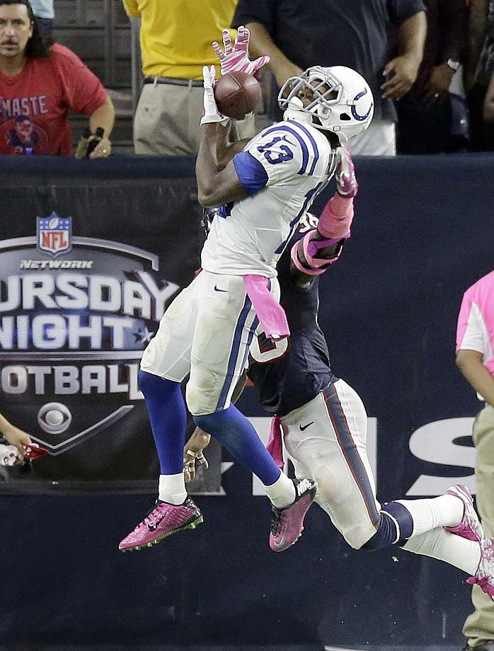 T.Y. Hilton catches a pass for a touchdown as Houston's D.J. Swearinger defends.