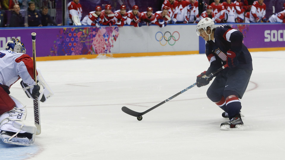 USA forward T.J. Oshie prepares to take a shot against Russia goaltender Sergei Bobrovski in an overtime shootout during a men's ice hockey game at the 2014 Winter Olympics.