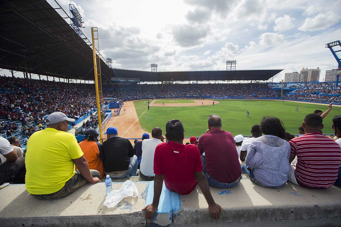 Fans watch the game between the Tampa Bay Rays and Cuban national team.