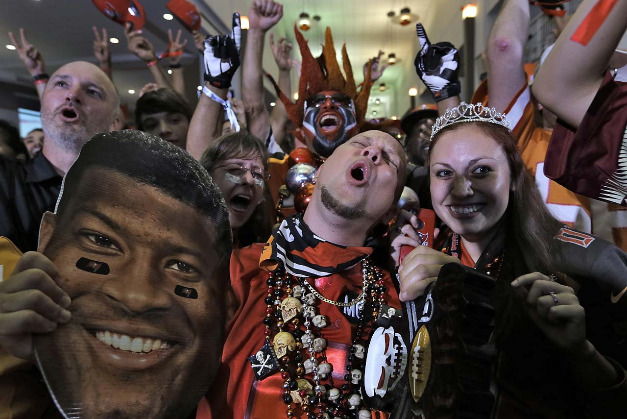 Tampa Bay Buccaneers fans react after their team drafted former Florida State quarterback Jameis Winston with the first overall pick during the NFL draft party in Tampa, Fla.