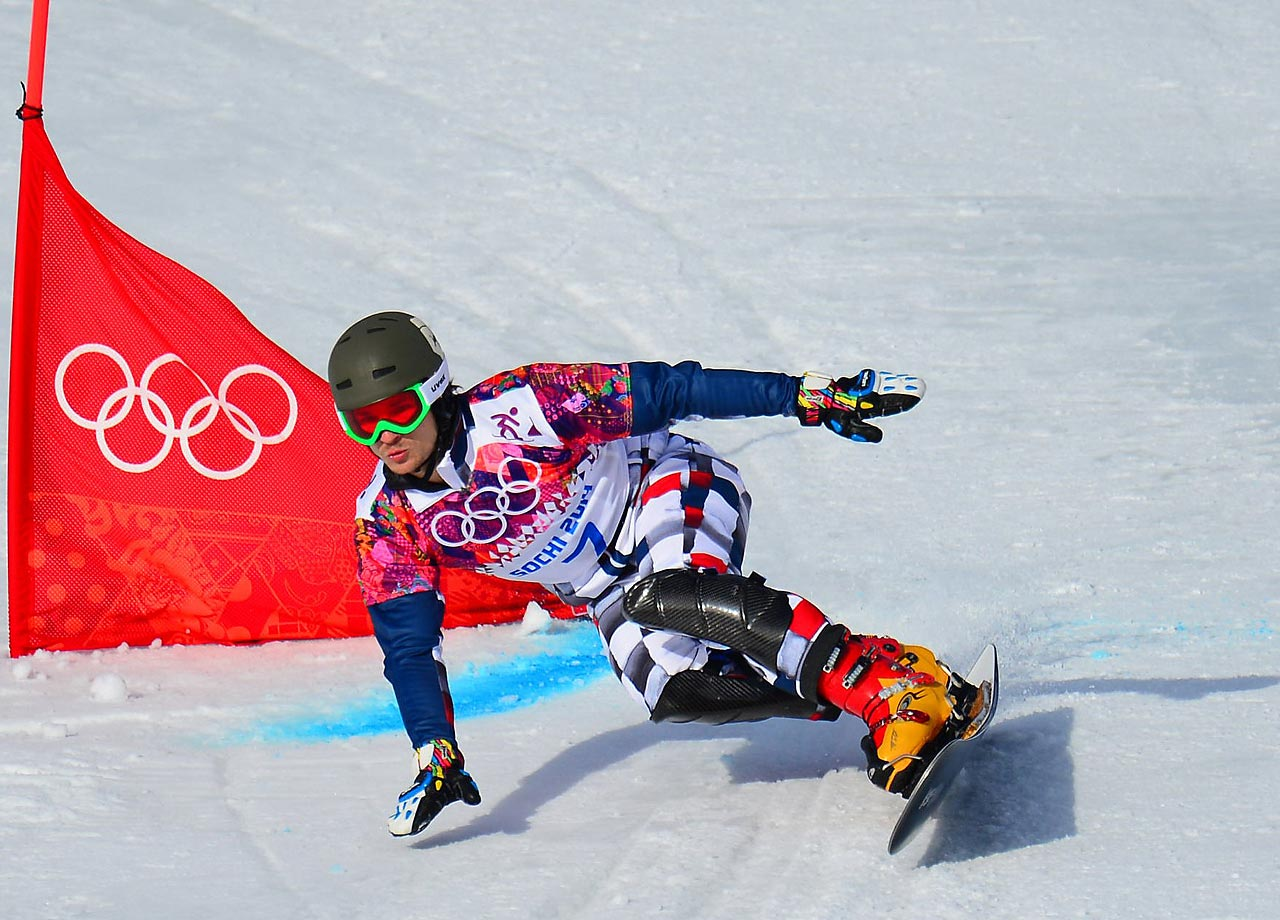 Snowboarder Vic Wild of Russia races through the men's parallel giant slalom course. Wild, a native of Washington state but a Russian citizen as of three years ago, won the gold medal for the competition.