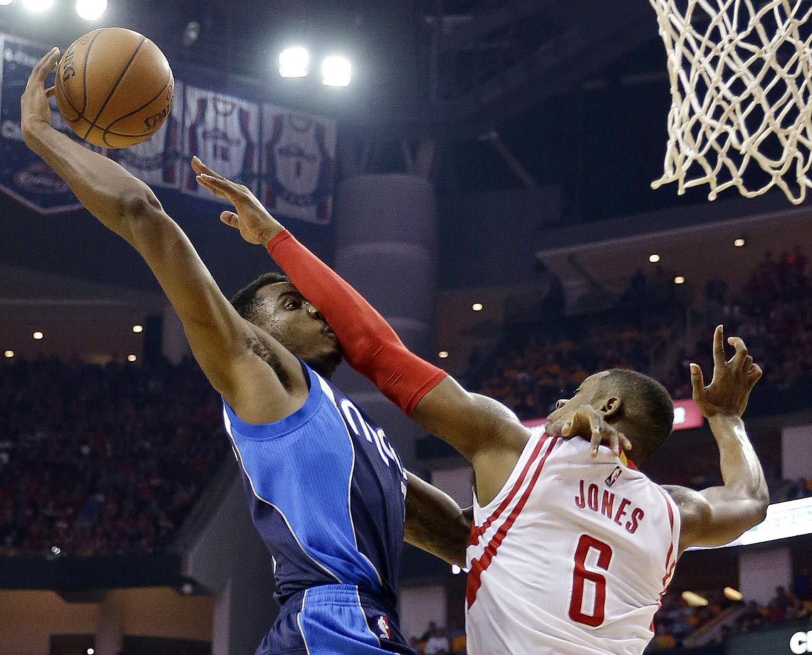 Mavericks' Al-Farouq Aminu and Rockets' Terrence Jones.