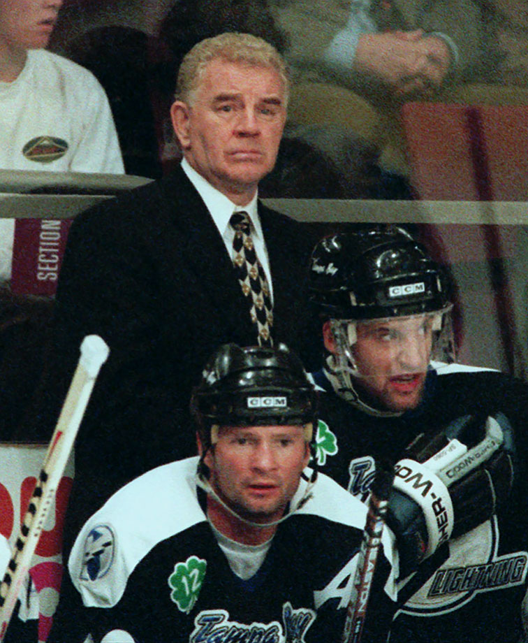 """A catatonic 2-7-2 start cost Tampa Bay the only coach it had known during the team's six-year history. When an 0-6-1 schneid deposited the Bolts in the Eastern Conference basement, GM Phil Esposito pulled the plug on Crisp, saying, """"This is not a happy day in Tampa Bay Lightning history. We've been together since the beginning. However, I was convinced breaking training camp our club was pretty good. It didn't seem like they were responding."""" Added forward Rob Zamuner, """"It was a situation I guess where Phil had to act. It's easier to fire one guy than 25 or 26."""""""