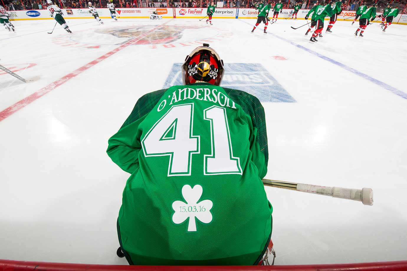 Craig Anderson of Ottawa wears a green St. Patrick's Day warm up jersey prior to a game against Minnesota.