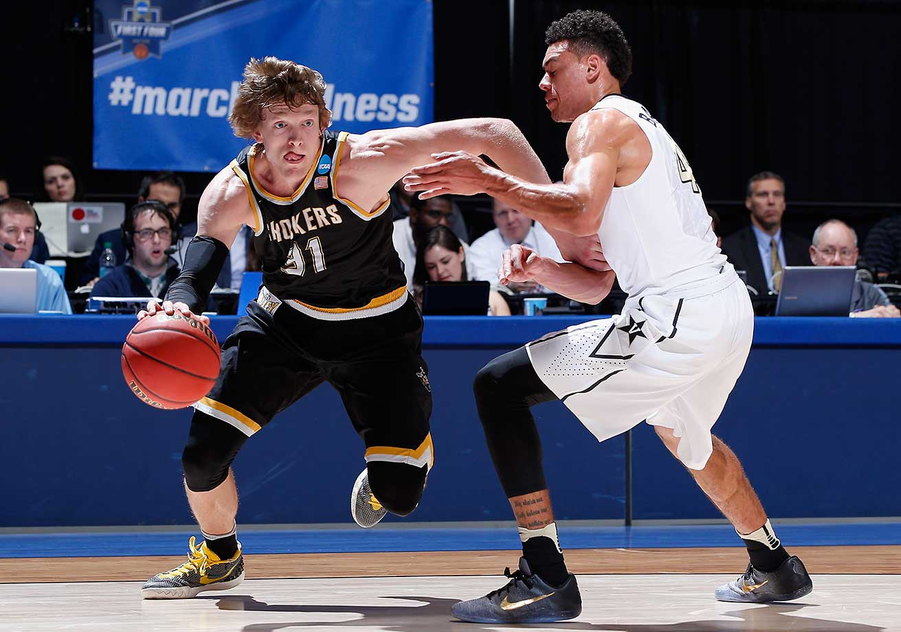 Ron Baker of Wichita State drives against Wade Baldwin IV of the Vanderbilt Commodores.
