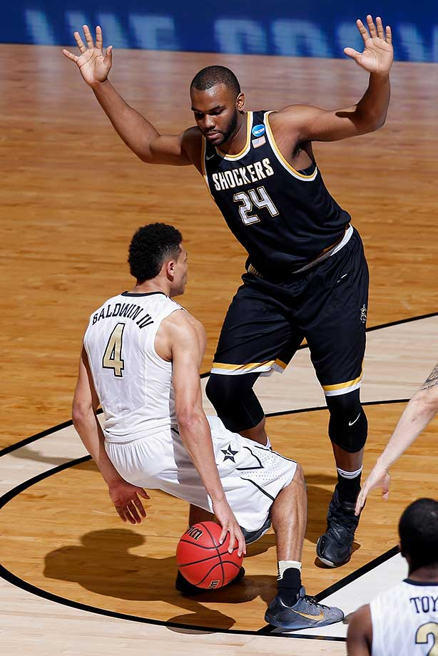 Wade Baldwin IV of Vanderbilt handles the ball against Shaquille Morris of Wichita State.