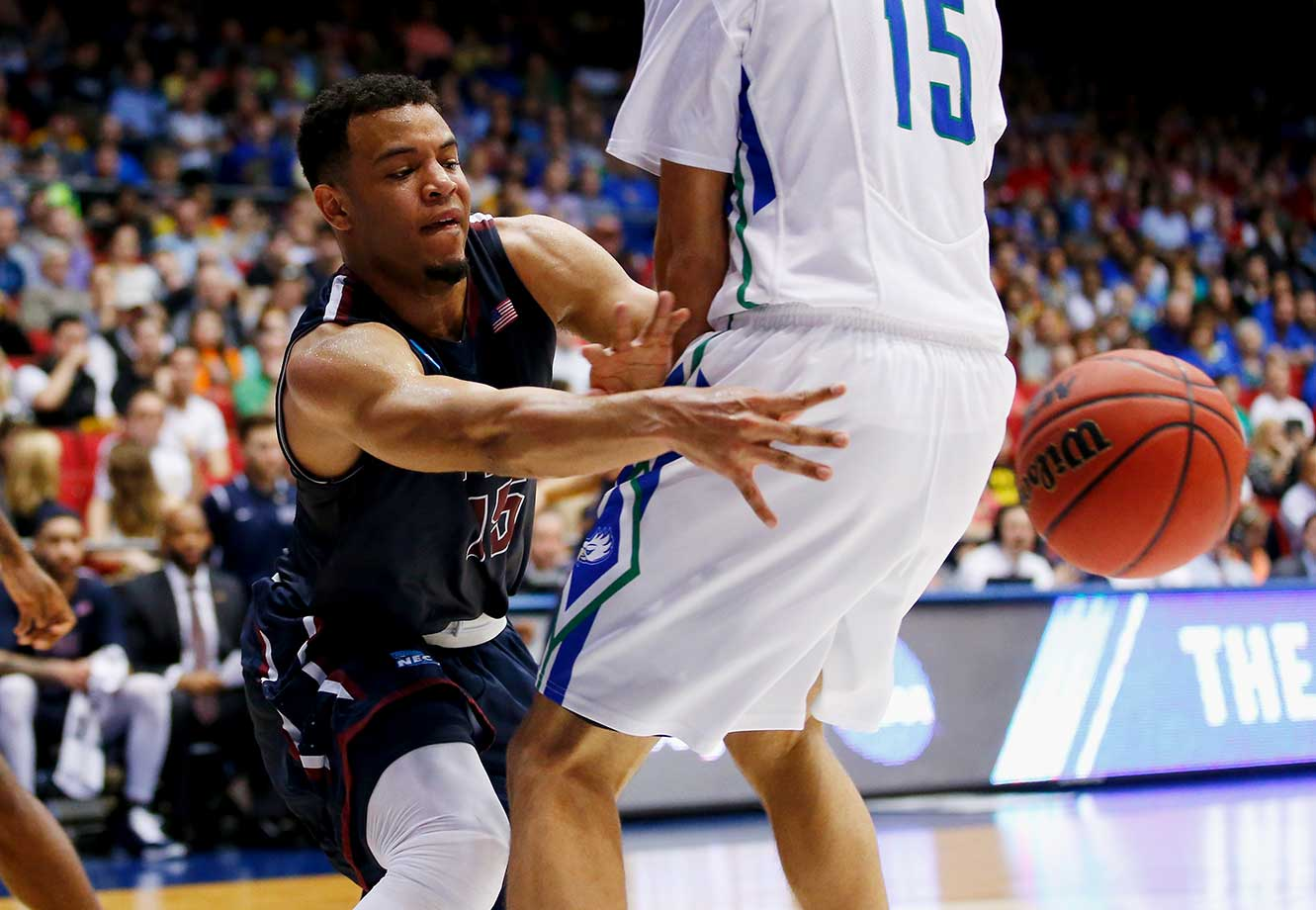 Marques Townes of Fairleigh Dickinson passes the ball against the Florida Gulf Coast Eagles.