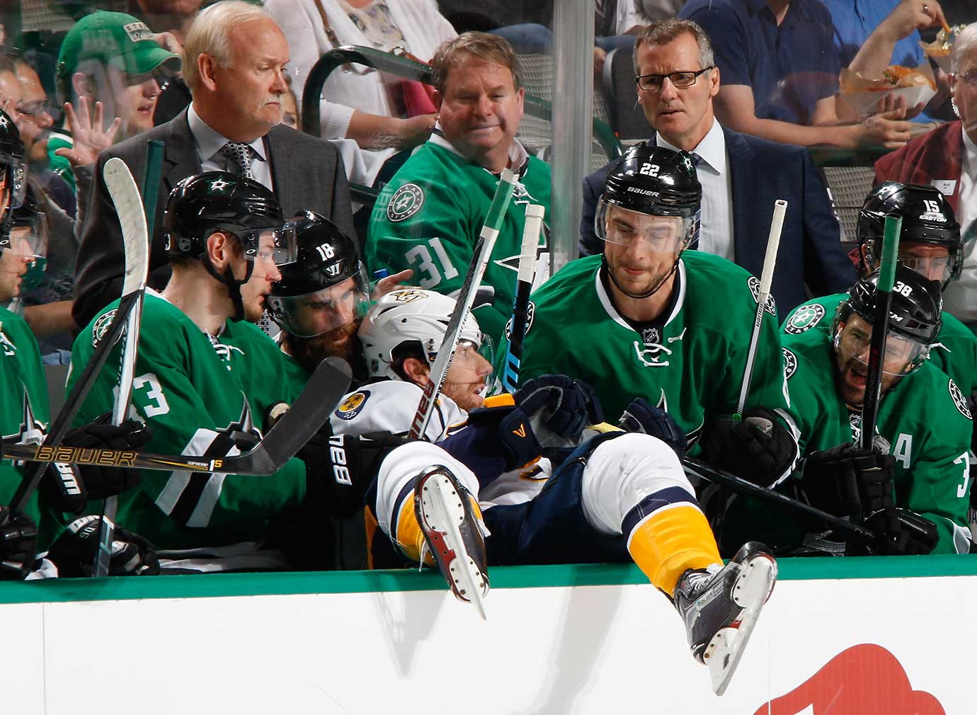 James Neal of the Nashville Predators gets checked into the bench against the Dallas Stars.