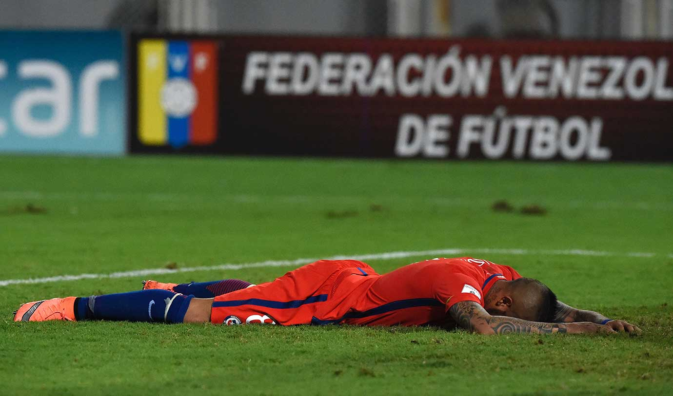 Chile's Arturo Vidal lies on the ground during the Russia vs. Venezuela World Cup qualifer.
