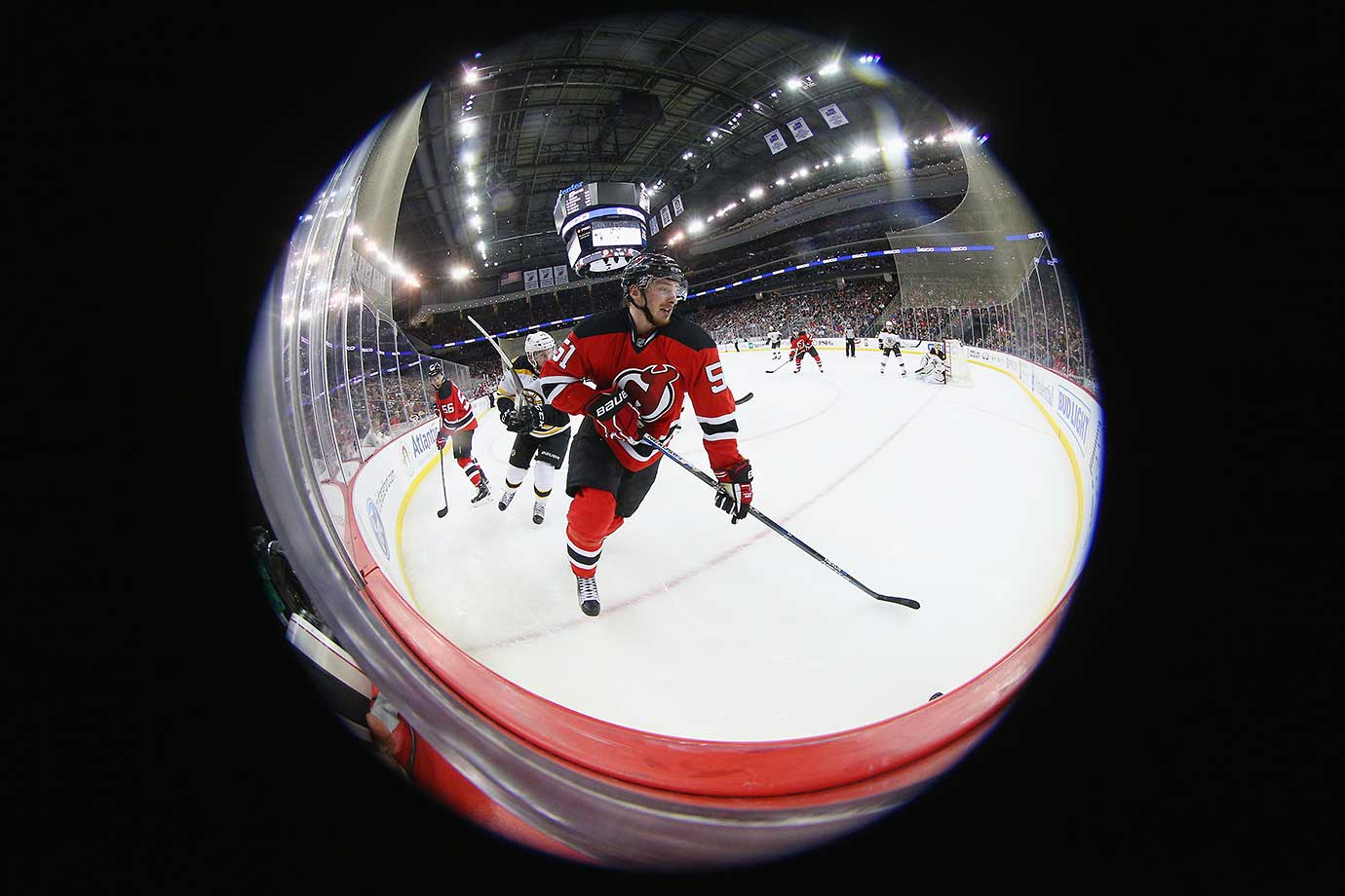 Sergey Kalinin of the New Jersey Devils skates against the Boston Bruins at the Prudential Center in Newark, N.J.