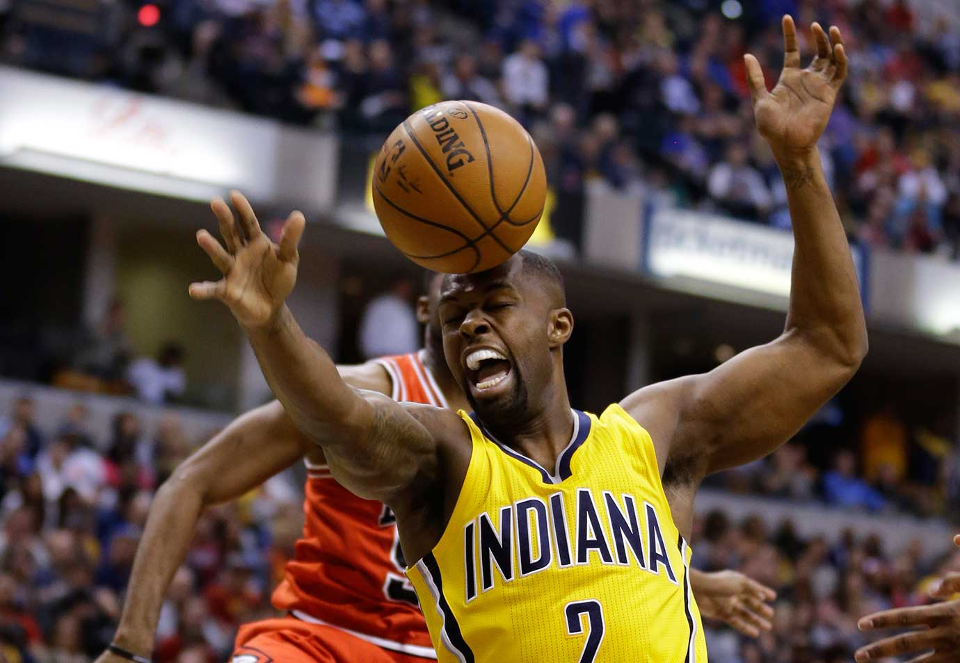 Indiana Pacers guard Rodney Stuckey loses the ball off the top of his head after being blocked by E'Twaun Moore, rear, of Chicago.