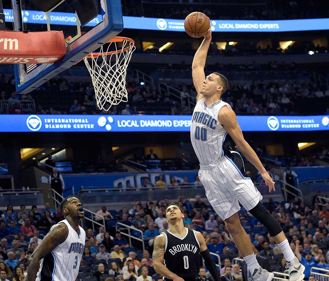 Orlando Magic forward Aaron Gordon goes in for a dunk over Brooklyn's Shane Larkin.