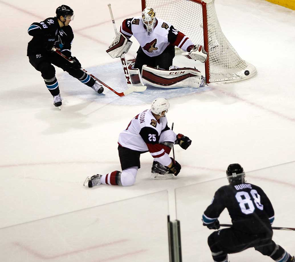 Arizona goalie Mike Smith makes a save during a game between the Coyotes and Sharks.