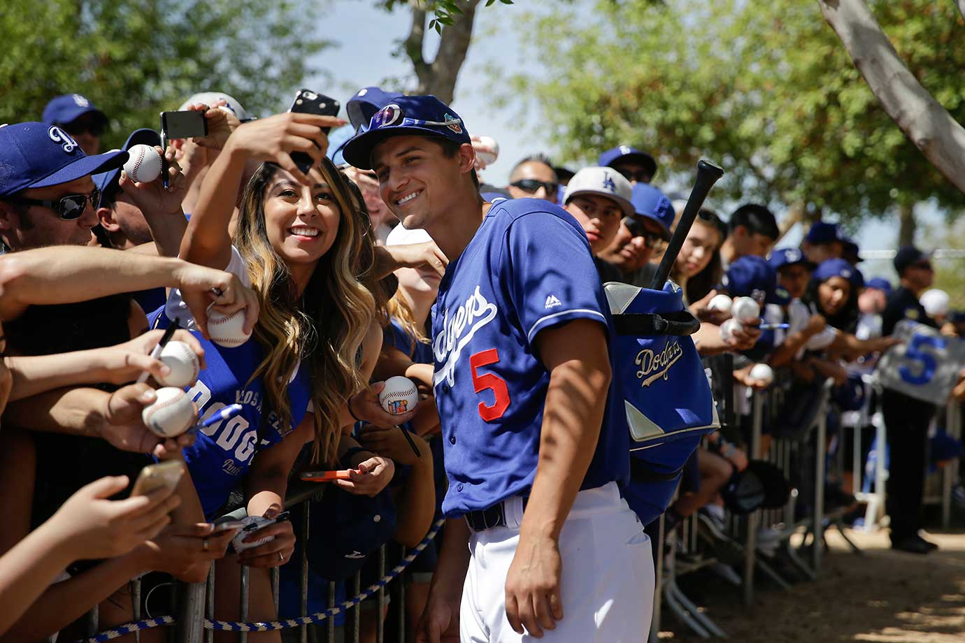 Los Angeles Dodger Corey Seager pauses for a photo with a fan before a spring training game in Phoenix.