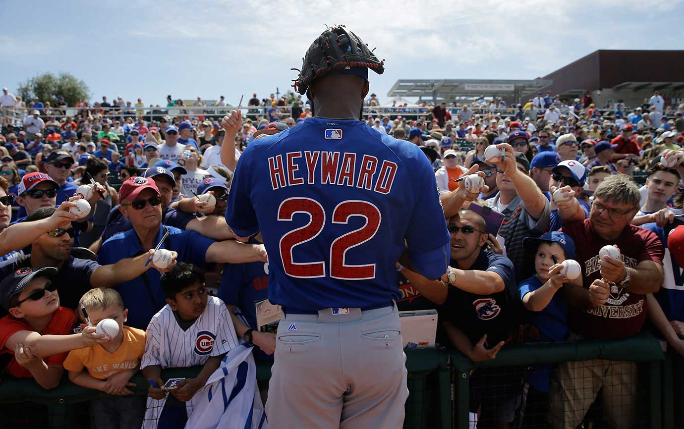 Jason Heyward of the Chicago Cubs signs autographs before a spring training baseball game against Cincinnati in Arizona.