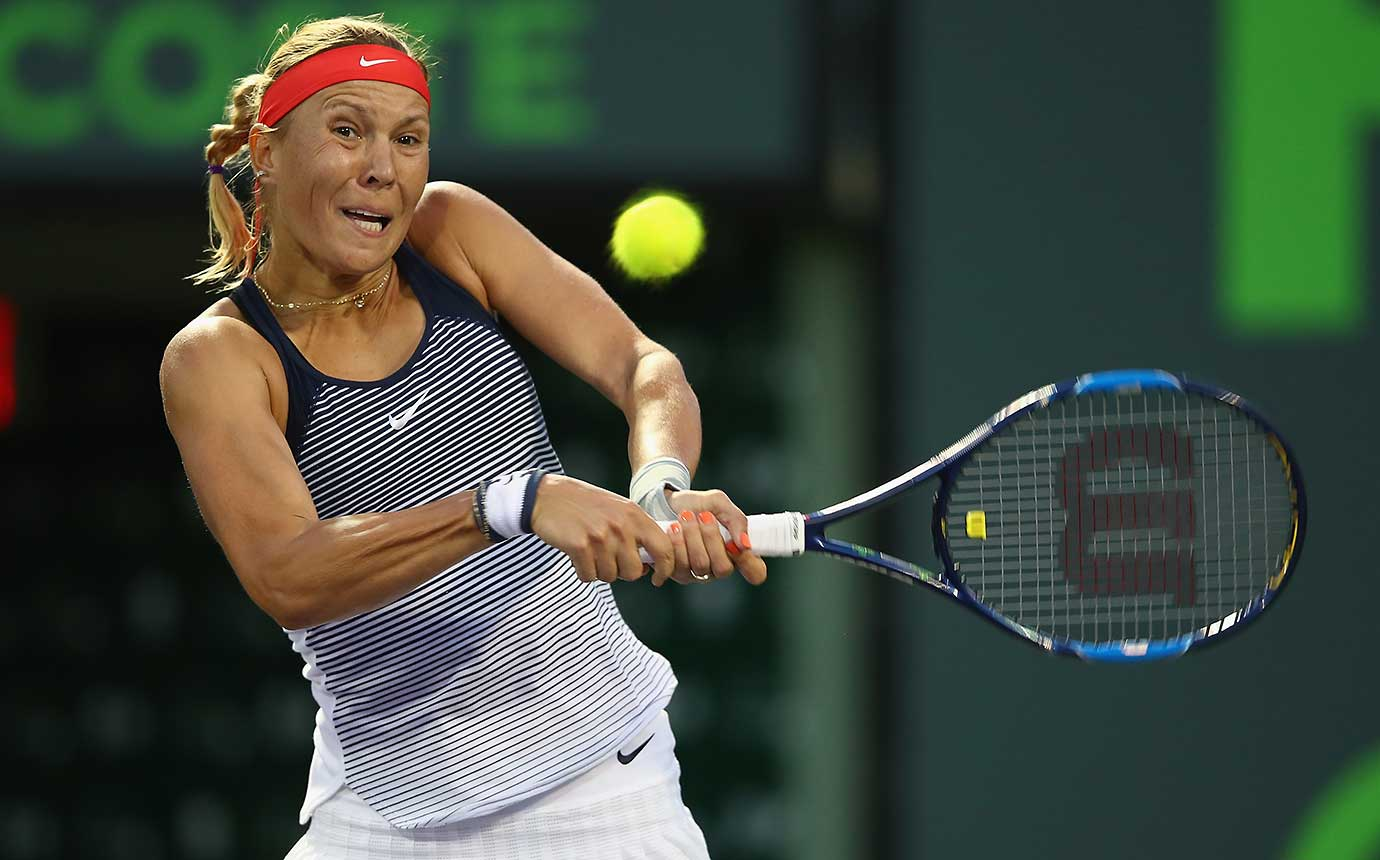 Lucie Hradecka of the Czech Republic plays a backhand against Eugenie Bouchard of Canada.