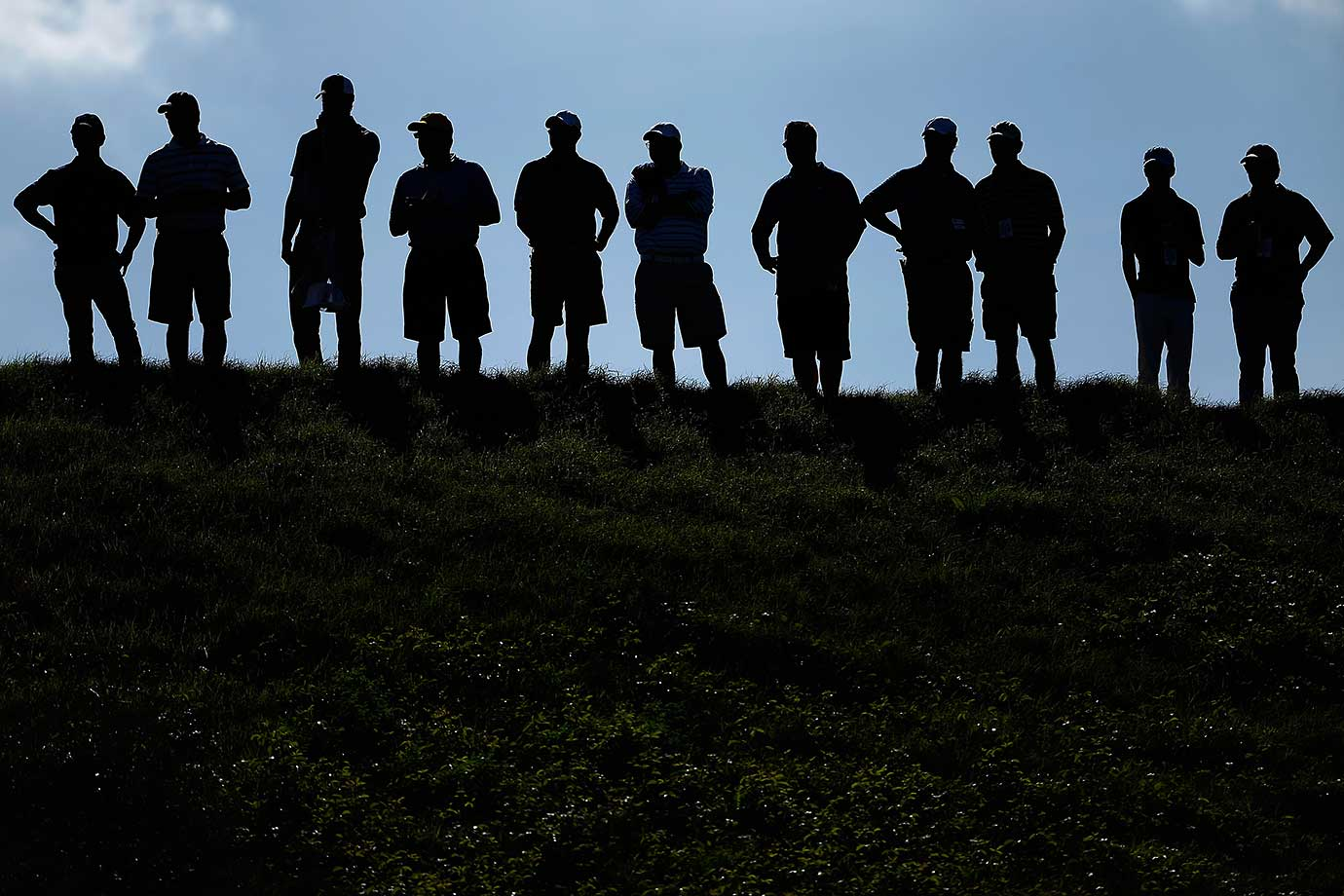 Fans watch the play above the 16th hole during the World Golf Championships-Dell Match Play in Austin, Texas.