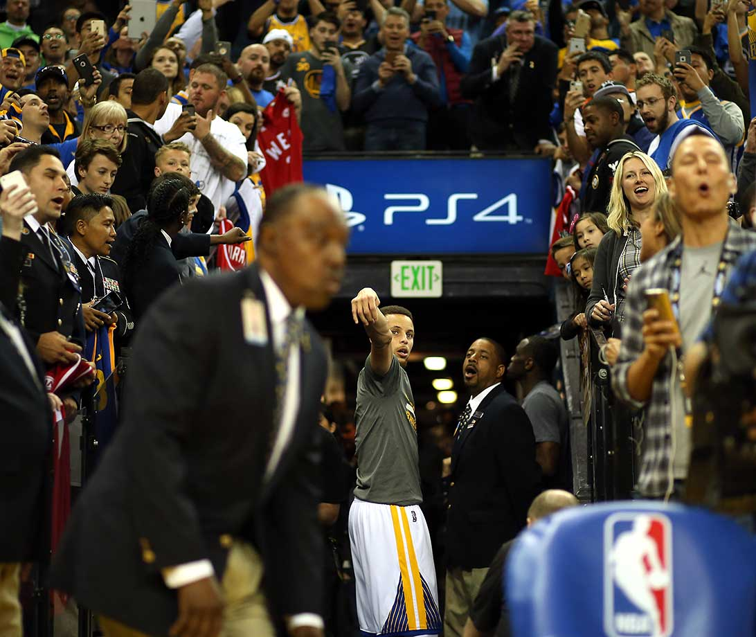 Steph Curry of the Warriors takes his ceremonial shot in the hallway before their game against the Los Angeles Clippers. Golden State set a record with its 51st consecutive win at home and improved to 64-7.